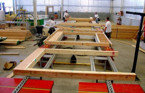 Our experienced framing crew assembles your precision built wall panels in a controlled environment...
